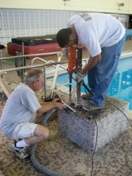 People Repairing Diving Board Base - Diving Board Repair